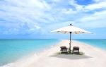 Aguas turquesas y playas de arena blanca.  El paraíso se llama Misha Cay.